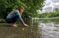 "Clare Kelley practices ""forest bathing"" along the edge of an urban forest on Washington D.C.'s Roosevelt Island, in the middle of the Potomac River. In contrast to hiking, forest bathing is less directed, melding mindfulness and nature immersion to improve health."