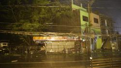 Strong winds and rain batter a town in Cagayan Province, as typhoon Mangkhut hits the Philippines. Witnesses say the storm's wind and rain ripped off tin roof sheets, and knocked out power in some places.